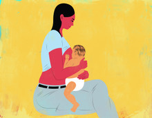 Seated breastfeeding mother