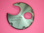 SHIMANO TGT0544 LEFT SIDE PLATE COVER FOR TEKOTA 300LC, 300LCM,  500LC, 500LCM,  600LC, & 600LCM