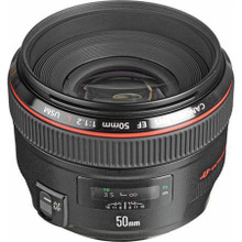 """Get this Canon EF 50mm f/1.2L USM Lens, """" Open Box """", normally $1,449.00, on sale at $1,249.00 for a total savings of $200.00 and Shipping is free!  The EF 50mm f/1.2L USM Lens - Serious Glass for Serious Photographers   The EF50mm f/1.2L USM lens is now the fastest autofocus lens in its class, which makes it an essential tool for many professional and advanced amateur photographers.   Canon is the only camera manufacturer to provide professionals and advanced amateurs with Digital SLRs that feature full frame sensors, such as the Canon EOS-1Ds Mark II and EOS 5D digital SLRs. The new EF50mm f/1.2L USM lens complements full-frame cameras, while delivering beautiful results on APS-C/H sized sensor models as well.   The EF50mm f/1.2L USM lens is a strong testament to Canon's heritage of optical excellence. Every aspect of this lens exudes professional quality from its wide 72mm filter diameter to its dust and moisture sealed construction.   A high refraction glass molded aspherical lens element helps to minimize spherical aberration, which is crucial in order to provide fine detail and maximum image quality from corner to corner, even when the lens is used wide open.   Full frame digital camera users will especially appreciate the benefits of the 50mm focal length, when shooting waist-up portraits while maintaining appropriate subject distance at a wedding.   The large maximum aperture of f/1.2 allows this lens to produce shallow depth of field that softens the background and makes subjects """"pop"""" out of a portrait. Photographers can also take advantage of higher shutter speeds to shoot in lowerlight and help prevent blurring caused by subject movement or camera shake.   In addition to a large aperture, the new lens also has blazingly fast autofocus speed and response time, thanks in part to Canon's ring-type Ultrasonic Motor (USM), which quietly drives the lens. A full-time manual focus feature allows photographers to fine-tune the sharpness of their images, even when"""