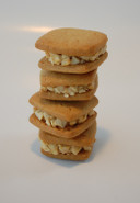 We raised the bar on the common peanut butter cookie. Our peanut butter cookie is crisp and light sandwiched with a nice peanut creamy filling.
