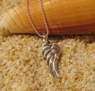 Angel Wing Charm handmade from reclaimed pure silver by U.S. artist Tracy Menz.