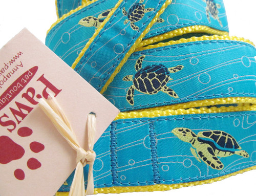 Sea Turtles are gliding through the blue watery ribbon on our turtle dog leashes.