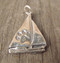 Paw Sailboat Charms are made with recycled fine silver.