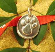 Each paw charm is beautifully imperfect due to the handmade nature.