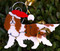 Pet Ornaments are finished with a Santa hat like this Cavalier King Charles Ornament.