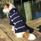Gracie is wearing a size medium navy nautical sweater.