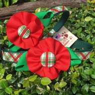Holiday Plaid Dog Collars with Flower shown in size small and medium