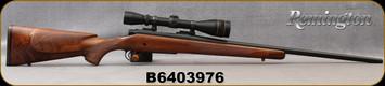 "Consign - Remington - 22-250Rem - Model 700 Custom Shop - LH - Satin Finish Grade III American Walnut w/Rosewood Tip/Polished Blued, 24""Barrel, c/w Leupold Vari-X 2c 4-12x40AO, duplex, custom shop papers - only 200rds fired - In green hard case,"