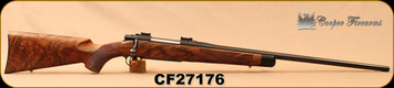 "CONSIGN - COOPER - 275RIGBY/7X57 - MODEL 52 - AAA+ FRENCH WALNUT W/EBONY FOREND CAP/BLUED, 24""BARREL, STEEL BUTT-PLATE, SKELATONIZED GRIP PLATE - LOW ROUNDS FIRED - C/W 200+ PCS. BRASS & FACTORY AMMO"