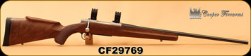 """Consign - Cooper - 6.5Creedmoor - Model 54 Jackson Game - AA+ Claro Walnut stock w/roll over cheek piece & semi-beavertail forearm/Stainless Action/Blued, 24""""Barrel, Pachmayr recoil pad, steel grip cap, 30mm rings"""