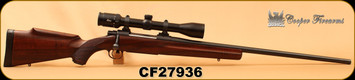 "Consign - Cooper - 6.5x55 - M52 Jackson Game - AA+Claro Walnut w/roll over cheekpiece/Matte Blued, 24.8""Barrel, 2 Detachable mags, c/w Leica ER 3.5-14x42, Duplex reticle w/parallax adjustment, - In Black hard plastic case"
