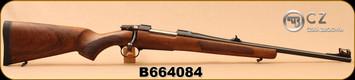 "CZ - 243Win - 557 Carbine - Bolt Action Rifle - Oil-Finished Turkish Walnut stock with cheekpiece/Blued, 20.5""Barrel, 4rd Hinged Floorplate, 1:8.6""Twist, Fiber Optic Front Sight, Mfg# 04851, S/N B664084"