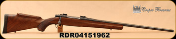 "Consign - Cooper - 338-06 - Model 52 Jackson Game - AAA walnut/blued, grade III engraving, 24"" fluted barrel, 2 engraved magazines, engraved 30mm case colored rings, additional synthetic stock (Black w/Red Web), in original box"