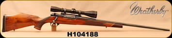 "Consign - Weatherby - 300WM - Mark V Deluxe - Gloss Walnut stock w/Ebony Forend/Blued, 26""Barrel, made in Japan, c/w Leupold Vari-X II, 3-9x42mm, Duplex Reticle"