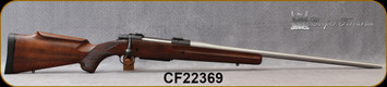 """Consign - Cooper - 7mmSTW - M56 Jackson Game - Walnut Stock w/Roll-over cheekpiece/Stainless, 26""""Barrel, Warne Bases, c/w Grey Laminate Stock, New Dies - Low rounds fired - In original box with papers"""