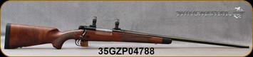 "Used - Winchester - 338WinMag - Model 70 Super Grade - Bolt Action Rifle - Grade IV/V walnut, ebony forearm tip/Polished Blued, 26"" Barrel, jeweled bolt body, 5 Rounds, Adjustable Trigger, Mfg# 535203236, 1""Rings"
