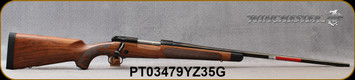 "Winchester - 300WM - Model 70 Super Grade French Walnut - Bolt Action Rifle - AAA French Walnut Stock w/Ebony Forearm Tip/'Super Grade' Engraved Hinged Floorplate/Polished Blued, 26""Barrel, Mfg# 535239233, S/N PT03479YZ35G"