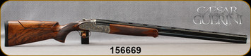 """Consign - Caesar Guerini - 12Ga/2.75""""/32"""" - Maxum Gold - Checkered Extra deluxe grade Turkish Walnut/deep relief floral scroll hand finished engraved receiver/Blued, Vent-Rib Barrels, 8-6 mm solid tapered top rib, c/w 6pcs chokes - In original fitted"""
