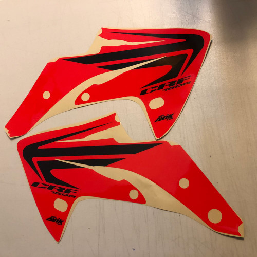 CRF150R Wing Shroud Graphics Red Background