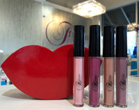 4 Pefect Holiday Glosses in a resuable Lip Shaped Box  Shades: Pink Oasis, Whisper,Pink Booty, Zen