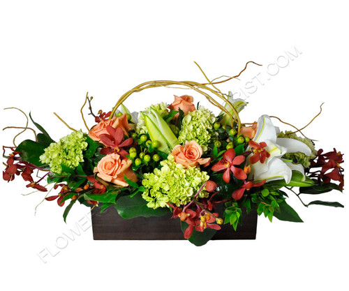 Send our vintage container filled with soft shades of the season and an added touch of  gentle creme lilies for fall or any occasion where being unique is important!