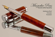 Handmade wood pen made from Amboyna Burl.  Handcrafted pen by our artist.  View of pen.