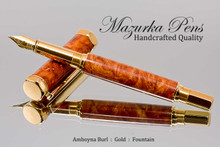 Handmade wood pen made from Amboyna Burl.  Handcrafted pen by our artist.  View of pen cap and tip.
