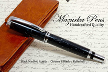Handmade acrylic pen made from marbled black acrylic.  Handcrafted pen by our artist.  Main iew of pen cap.