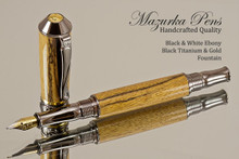 Handcrafted Fountain pen made from Black and White Ebony with Black Titanium / Gold finish.  Cap view of pen and cap.