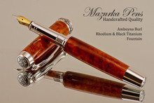 Handcrafted fountain pen made from Amboyna Burl with Rhodium/Black Titanium finish.  Nib view of pen and cap.