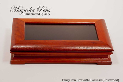 "Premium rosewood display case with brass hinges and 3"" x 6"" glass top (pen not included, shown closed)"
