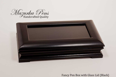 "Premium black wood display case with brass hinges and 3"" x 6"" glass top (pen not included, shown closed)"