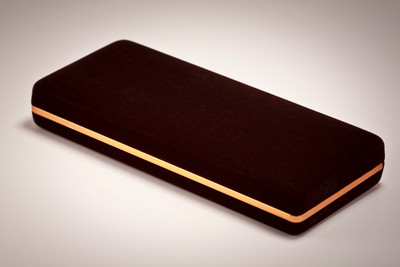 Brown velvet pen and pencil case with gold trim, show closed