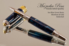 Handmade Rollerball Pen Handcrafted from a Sea Blue Green Resin with Rhodium finish and Gold accents.  Main view of pen and cap.