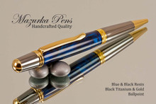Handmade Ballpoint Pen handcrafted from Blue/Black Poly-Resin with Black Titanium/Gold finish.  Top view of pen.