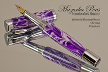 Handmade acrylic pen made from Wisteria Blossom Resin swirl poly resin.  Handcrafted Fountain Pen - made in our shop, no two alike.  Main view of pen body
