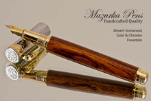 Handmade Fountain Pen made from Desert Ironwood with Gold colored finish with Chrome Accents.  Side view of pen.
