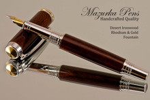 Handmade Fountain Pen made from Desert Ironwood with Rhodium and Gold color accents.  Cap view of pen.