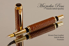 Handmade Fountain pen made from Brown Faux Leather with Gold / Black finish.   Main view of pen