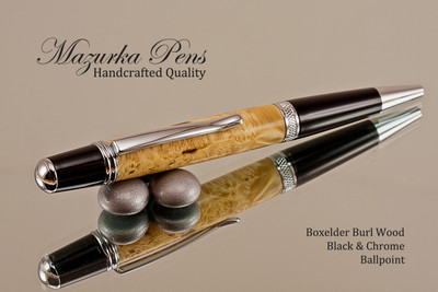 Handcrafted pen made from Boxelder Burl with Black  / Chrome finish.