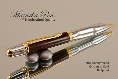 Handmade wood pen made from Mun Ebony with Chrome and Gold color finish.  Handcrafted pen by our artist.