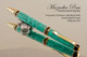 Handcrafted Ballpoint pen made from Turquoise TruStone with  Gold & Black finish.  Black Web and Three Ring accents.
