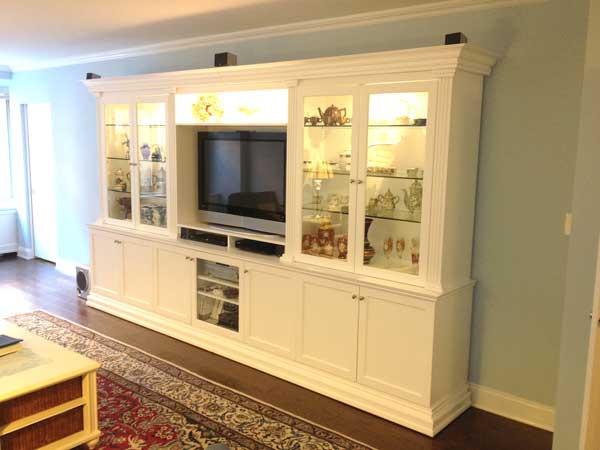 Custom White Entertainment Center With Glass Doors