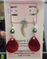 Green and White pearl beads on a Candy Red hammered spinner blades. Sterling Silver earrings, carded.