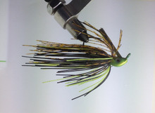 Missouri Crawdad Swim Jig. Candy Chartreuse weedless jig head. Silicone skirt has a mix of Black, Chartreuse and Banded Orange with Red glitter throughout.
