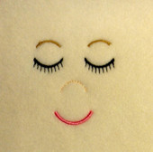 Embroidered Sleeping Doll With Smile Embroidery Machine Design