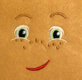 Doll Face Boy with Freckles and Smirk Embroidery Machine Design