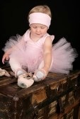 9994449-blond-toddler-wearing-a-tutu-holding-ballet-shoes.jpg