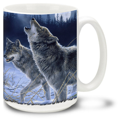 A pair of wolves howling during a moonlit winter night. By famed wildlife artists the Hautman Brothers. 15oz coffee mug
