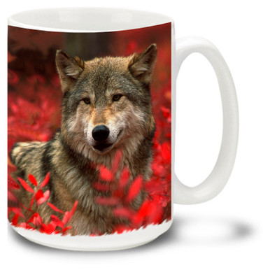 A noble lone wolf working his way through red autumn leaves on this great wolf coffee mug. 15oz wolf mug is dishwasher and microwave safe.